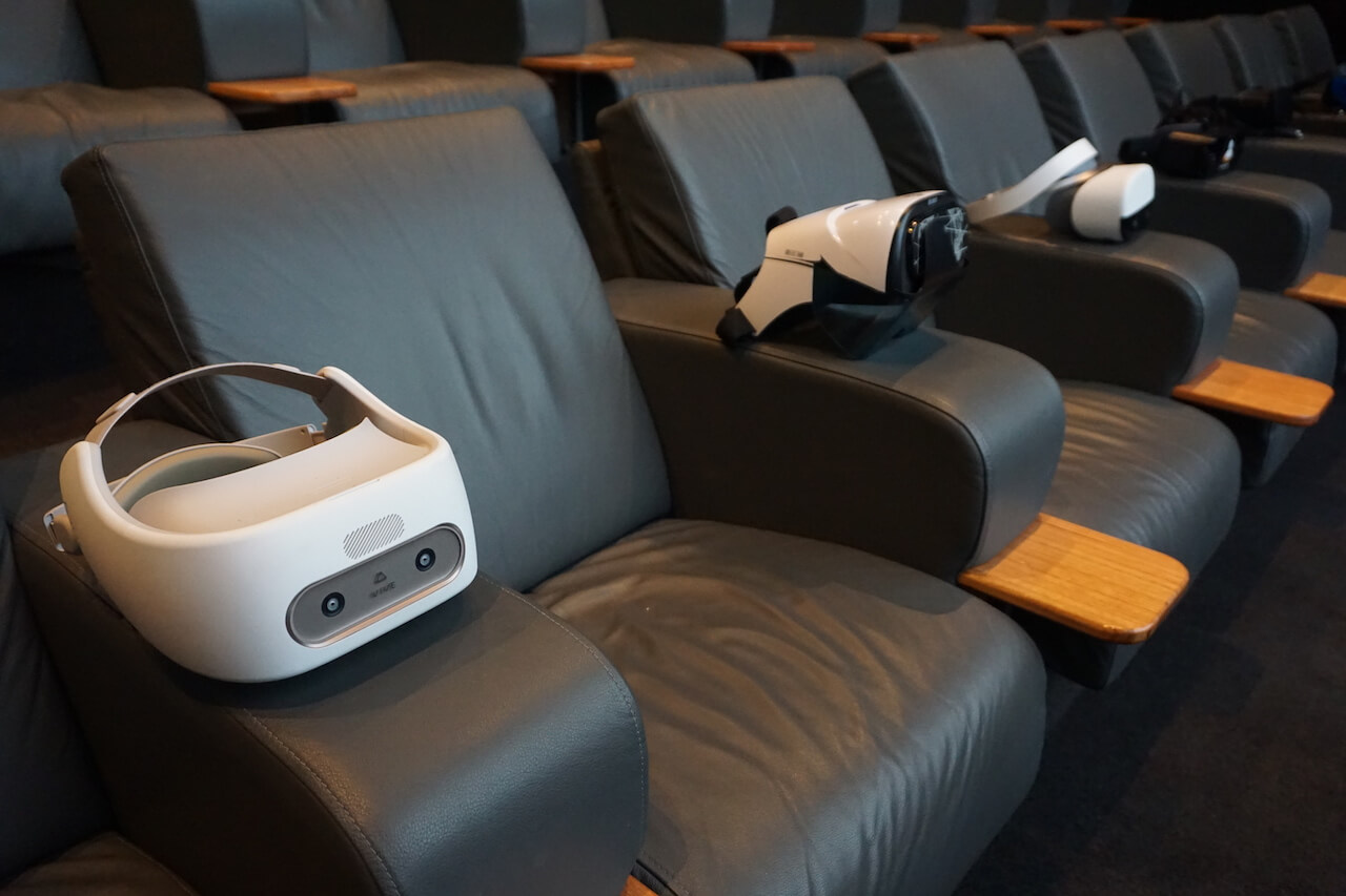 Chairs with VR headsets resting on them