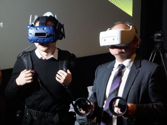 Two men wearing virtual reality headsets