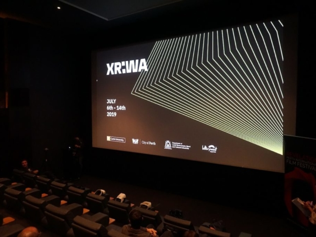 Cinema with large branded screen