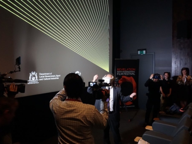 Man with VR headset being filmed